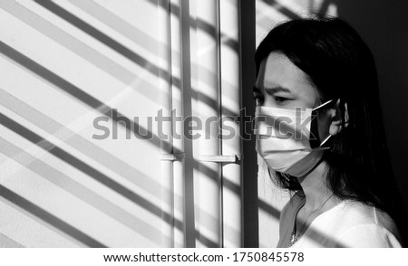 Black and white picture. woman wearing a face mask To prevent infection, illness and prevent coronavirus disease (Covid-19)