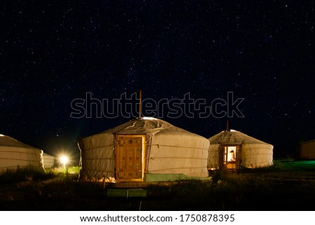 Starry sky over the gher camp (traditional Mongolian houses). Ugil lake, Mongolia #1750878395