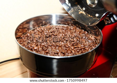 A picture of Just roasted brown coffee beans.