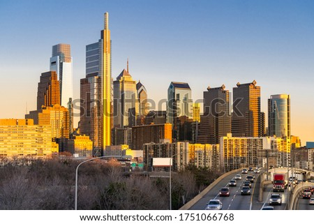Cityscape of Philadelphia skyscraper Skylines building sunset with interstate highway urban road transportation in Philly city downtown of Philadelphia in PA USA. Cityscape Urban lifstyle concept.