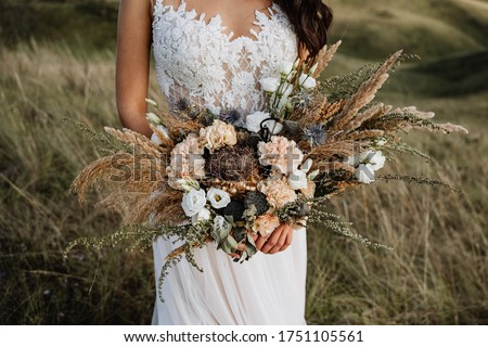 wedding bouquet of the bride, boho style, outdoor, dry flowers Royalty-Free Stock Photo #1751105561