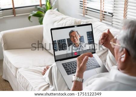 Asian senior video call with doctor telemedicine telehealth concept #1751122349