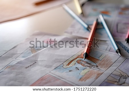 Video Pre-production for film movie storyboard concept : Color pencil drawing story board animation comic carton, design creative scene layout at studio. Behind process work before production films