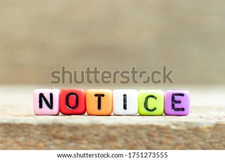 Colorful bead with black letter in word notice on wood background Royalty-Free Stock Photo #1751273555