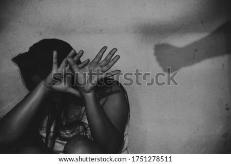 Man beating up his wife illustrating domestic violence. Violence in relationship.  Royalty-Free Stock Photo #1751278511