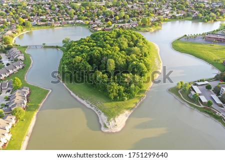 Aerial view of a peninsula located in Sterling Heights Michigan. Photo was taken in the late springtime around dusk. Drone Photography from above. #1751299640