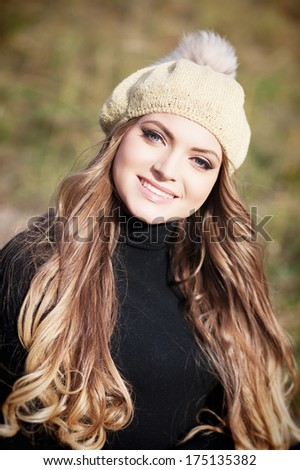Beautiful blond hair woman standing and posing at the park #175135382