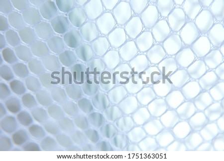 White mesh fabric textured background.White mesh with large holes