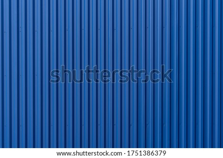 Striped Blue wave steel metal sheet cargo container line industry wall texture pattern for background. Royalty-Free Stock Photo #1751386379