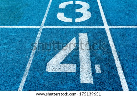 number three and four  on blue running track #175139651