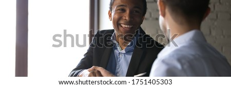 Multi ethnic happy businessmen shaking hands, executive manager and client making deal congratulate each other with successful negotiations decision, horizontal photo banner for website header design