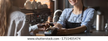 Customer stand near bar counter pay bill using cell application and pos machine. Mobile payment apps advertisement, smartphone is your wallet concept. Horizontal photo banner for website header design #1751405474