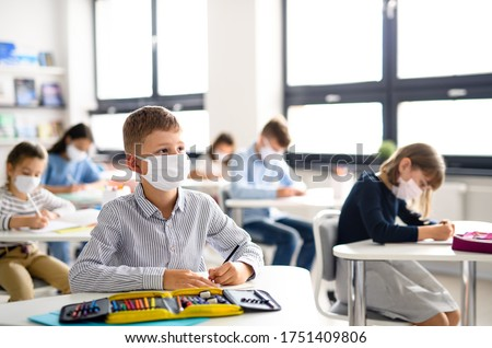 Children with face mask back at school after covid-19 quarantine and lockdown. Royalty-Free Stock Photo #1751409806