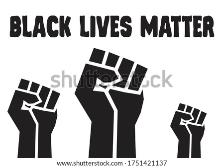 Black lives matter fists; The raised, clenched fist has become a symbol of the Black Lives Matter movement Royalty-Free Stock Photo #1751421137