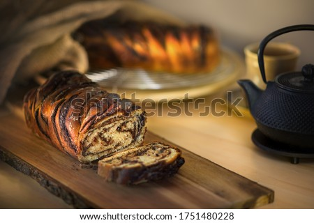 Babka, traditional jewish bread-like cake swirled with chocolate or cinnamon and often topped with nuggets of cinnamon-sugar streusel, popular mainly in America, where it was brought by immigrants. #1751480228
