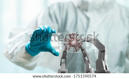 Doctor in hazmat suit holding transparent tablet to control white mechanical robotic arm with red virus. coronavirus concept. 3d Royalty-Free Stock Photo #1751590574