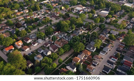 Aerial view of american suburb at summertime.  Establishing shot of american neighborhood. Real estate, residential houses. Drone shot, from above Royalty-Free Stock Photo #1751660906