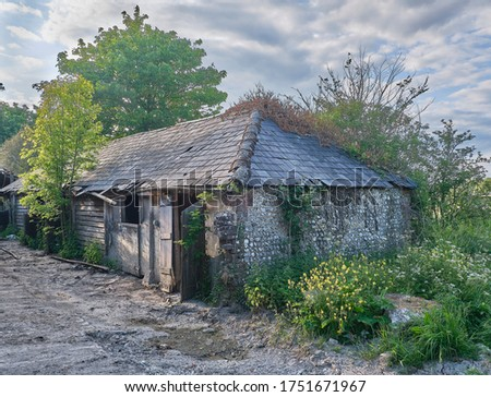 Derelict farm building in Sussex UK Royalty-Free Stock Photo #1751671967