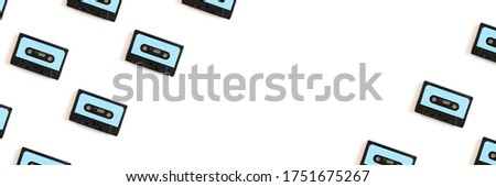 Creative cassette tapes pattern on a white background. Banner with copy space.