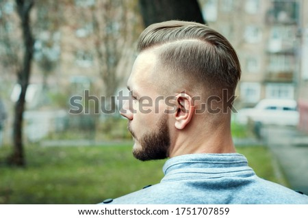 sport young man with a modern trendy fade profile haircut for barbershop. Royalty-Free Stock Photo #1751707859