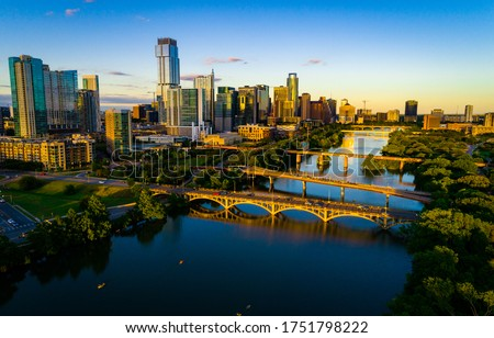 The travel destination of Texas - Austin Texas Sunset Golden hour aerial drone views above Town Lake or Colorado River