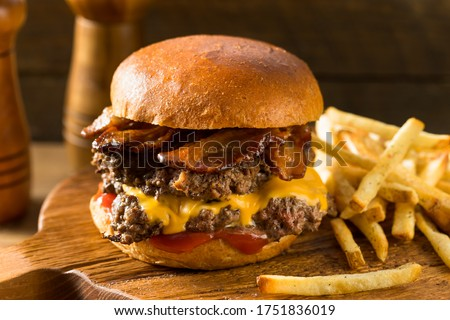 Rustic Homemade Bacon Smashburger with Cheese and Bacon Royalty-Free Stock Photo #1751836019