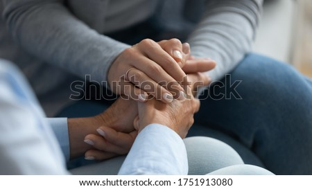 Adult daughter comforting old mom strokes holds her hand close up view. Strong connection confidential conversation, empathy and mercy, support in hard life period, be near sharing heart pain concept #1751913080