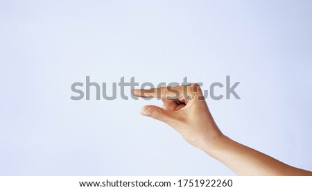 woman caucasian hand gesture of showing small size with two fingers, isolated over white background. Showing small thing gesture. Royalty-Free Stock Photo #1751922260
