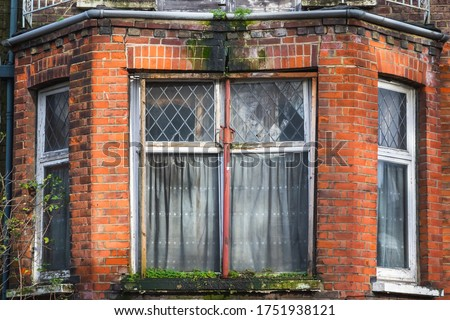 Bay window of an abandoned terrace house around Hornsey in London Royalty-Free Stock Photo #1751938121