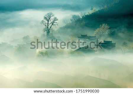 China Old City Town Anhui Landscape. Ancient Traditional Chinese Architecture Houses in Fog View. Peaceful Green Trees and Small Rural Village. Rustic Background Image. Royalty-Free Stock Photo #1751990030