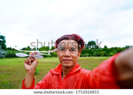 Pictures of people enjoying a rubber airplane powered by the potential energy stored by rotating propellers.