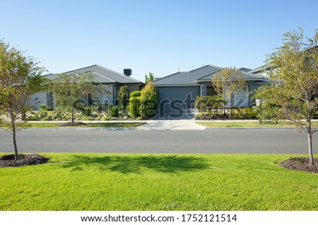 Residential neighbourhood street with some modern Australian homes. The beautiful environment in Melbourne's suburb. Wyndham Vale, VIC Australia. Royalty-Free Stock Photo #1752121514