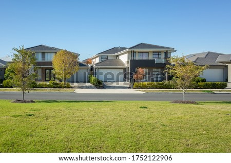 Residential neighborhood street with some modern Australian homes. The beautiful environment in Melbourne's suburb. Wyndham Vale, VIC Australia. Royalty-Free Stock Photo #1752122906