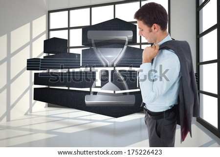 Smiling businessman holding his jacket against room with a lot of windows #175226423
