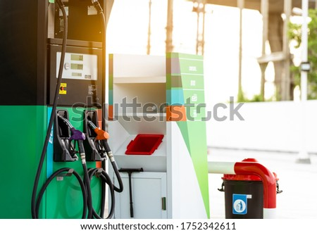 Petrol pump filling nozzle in gas station. Fuel dispenser machine in gas station. Petrol gasoline and gasohol. Petrol industry and service. Petrol price and oil crisis concept. Petroleum oil industry. #1752342611