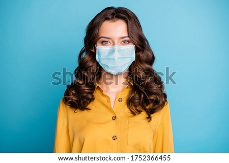 Close-up portrait of her she nice attractive wavy-haired girl wearing reusable gauze mask mers cov ncov virus infection influenza therapy isolated bright vivid shine vibrant blue color background Royalty-Free Stock Photo #1752366455