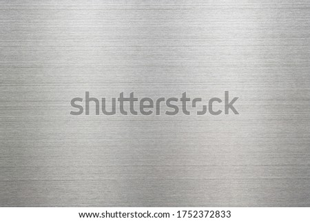 Abstract metal texture of brushed stainless steel plate with the reflection of light. #1752372833