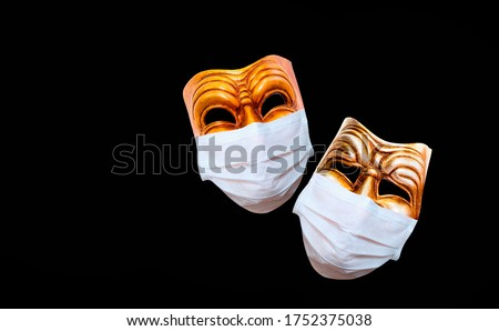 Comedy and tragedy theatrical mask  wearing protection medical mask for Corona virus (Covid-19) Royalty-Free Stock Photo #1752375038