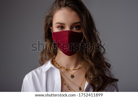Fashion: model wearing trendy outfit with protective face mask. Stylish look during quarantine of coronavirus outbreak. Copy, empty space for text #1752411899