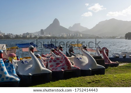 Beautiful view to swan paddleboats by Rodrigo de Freitas lagoon in the South Zone of Rio de Janeiro, Brazil #1752414443