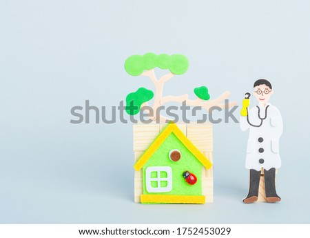 A doctor staying by house with tree. Children's cartoon doctor, National Doctors' Day