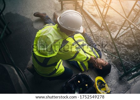 Construction worker accident, Accidents at work, Builder accident fall scaffolding to the floor, Safety team help employee accident, Basic first aid training for support accident in site work. #1752549278