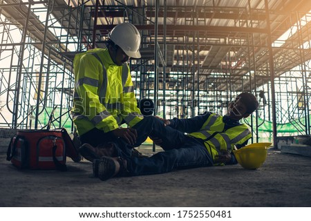 Construction worker accident, Accidents at work, Builder accident fall scaffolding to the floor, Safety team help employee accident, Basic first aid training for support accident in site work. #1752550481
