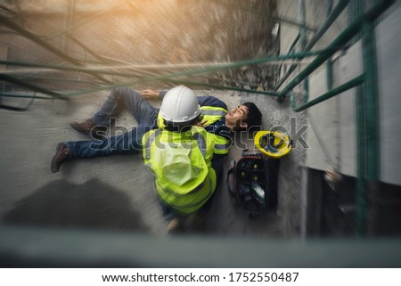 Construction worker accident, Accidents at work, Builder accident fall scaffolding to the floor, Safety team help employee accident, Basic first aid training for support accident in site work. #1752550487