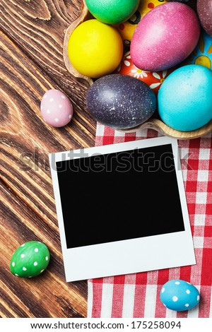 Easter colored eggs and an old picture frame