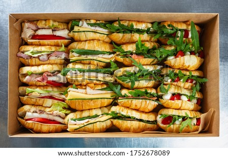 Food catering service.Fresh French croissants delivered in cardboard  box for venue.Delicious snack food cooked with natural & healthy ingredients for lunch meal #1752678089