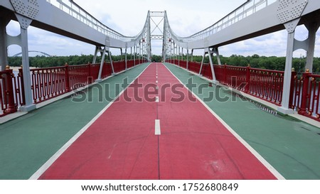 Park pedestrian bridge over the Dnieper River, which connects the central part of Kiev with the park area and the beaches of Trukhanovy Island. Without people. #1752680849