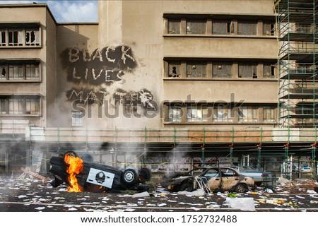 Black Lives Matter protest riot vandalism, looting aftermath concept, flaming police car smashed, overturned with black lives matter text slogan message on building. Excessive force, police brutality #1752732488