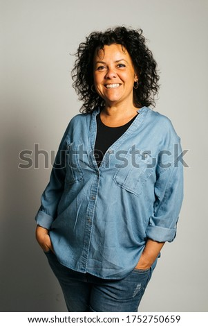 Studio portrait of a middle-aged smiling woman