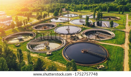Aerial view of wastewater treatment plant, filtration of dirty or sewage water. Royalty-Free Stock Photo #1752757748